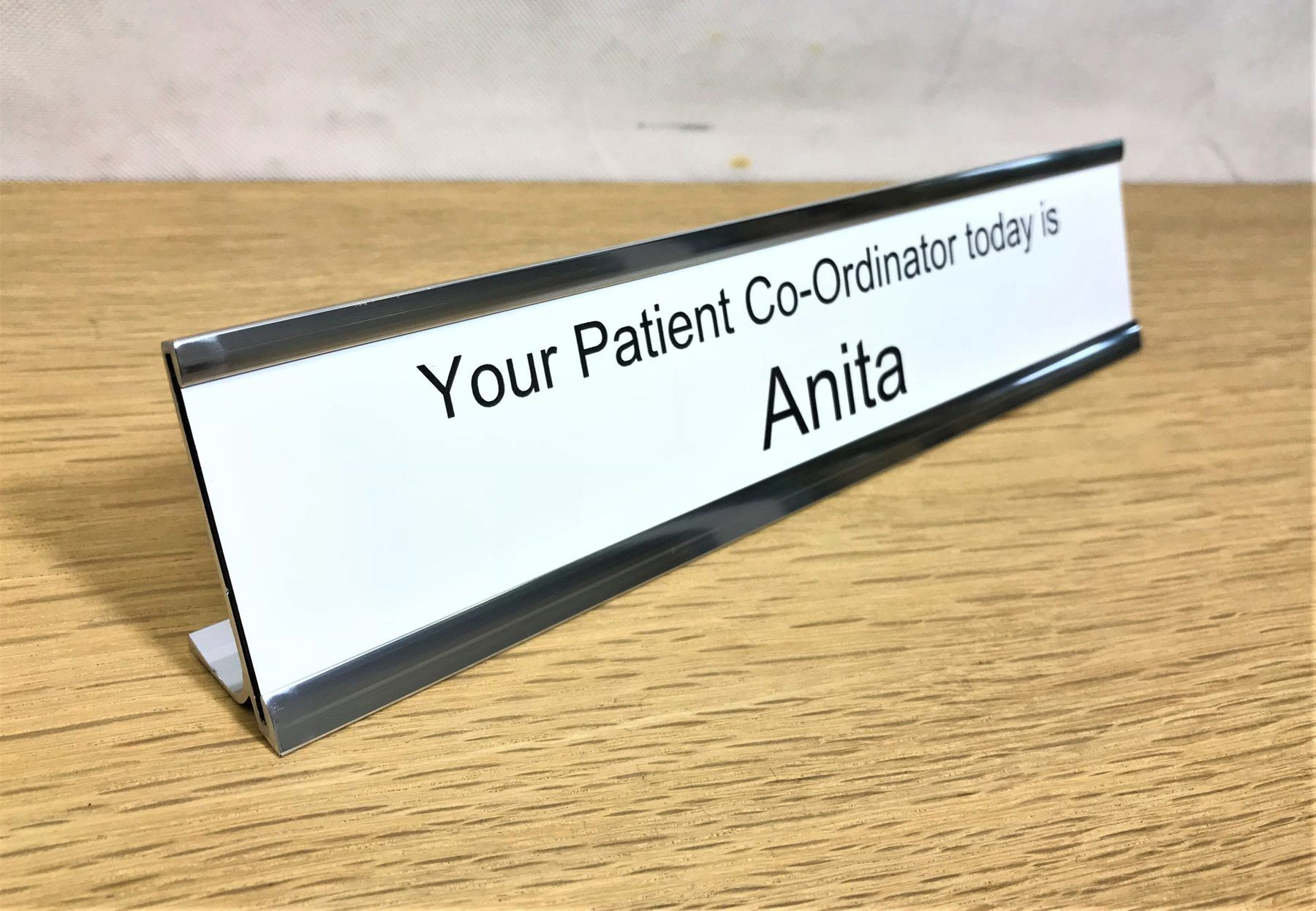Desk signs with white laser engraved durable plastic inserts