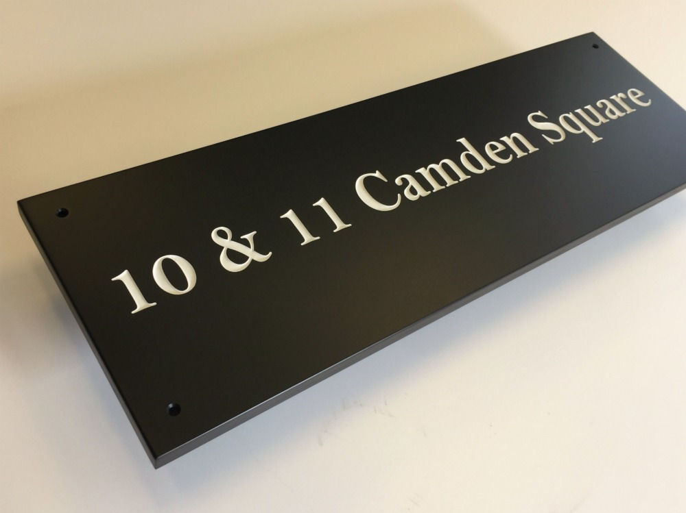 large slate sign with white letters